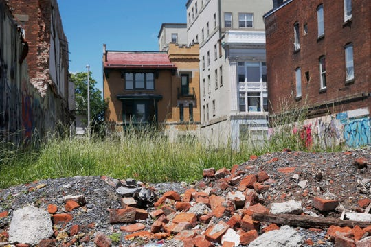 Rubble and grass occupy the former location of 17 & 19 Academy Street in the City of Poughkeepsie on June 11, 2019.