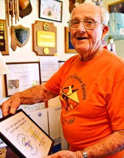 John Barton, 93, talks about his certificate award for being 'most likely to make you smile' from the York County Senior Games during an interview at his home in Stewartstown, Tuesday, June 11, 2019. Barton, who will be the torch-bearer for the 2019 opening ceremonies, has participated in the games since 2007. Dawn J. Sagert photo