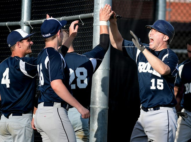 Glen Rock's Dan Rhodes (15) is congratulated after hitting a two-run homer against the Vikings during Central League play at Sunset Lane Park on Tuesday. Glen Rock lost the game, 5-4, but still sits in first place in the Central League at 9-1-1. Rhodes is one of the team's veteran standouts. Bill Kalina photo