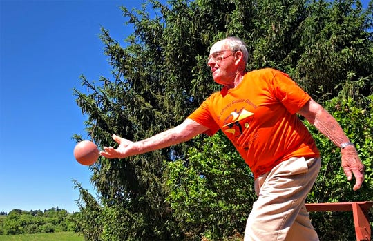 John Barton, 93, demonstrates how to play bocce on his bocce court in the back yard of his home in Stewartstown, Tuesday, June 11, 2019. Barton, who will be the torch-bearer for the 2019 opening ceremonies, has participated in the games since 2007. Dawn J. Sagert photo