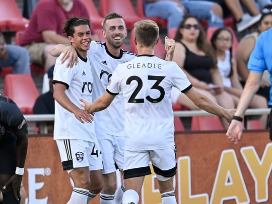 Reno 1868 FC's Cade Cowell, left, celebrates his first career USL goal on Saturday.