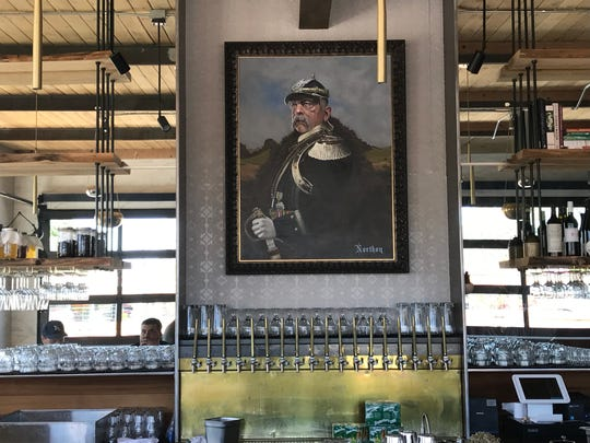 A potrait of Otto von Bismarck, the 19th century German chancellor and namesake of the new Von Bismarck restaurant, hangs above the back bar at the Wells Avenue spot that opened June 13, 2019, in Reno.