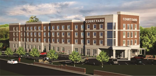 Plans for a new Courtyard by Marriott at East Avenue and Alexander Street.