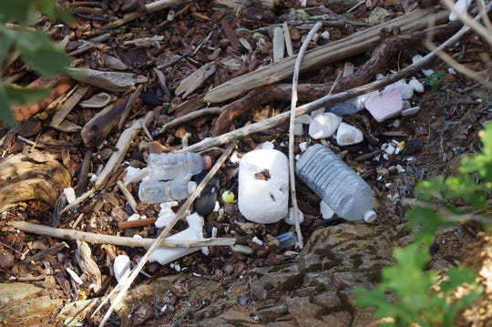 Plastic bottles, pieces of Styrofoam and other items washed up onto the shore of Lake Shasta on Tuesday.