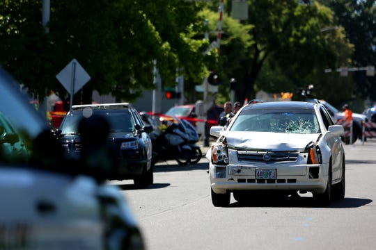 A Cadillac SRX is shown involved where a pedestrian was struck near Safeway at the intersection of Center Street NE and 12th Street NE in Salem on June 11, 2019.
