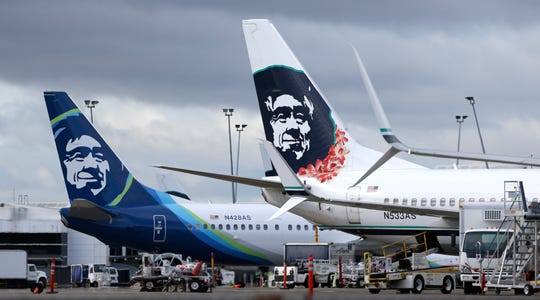 Alaska Airlines planes with the company's new livery and tail logo,
