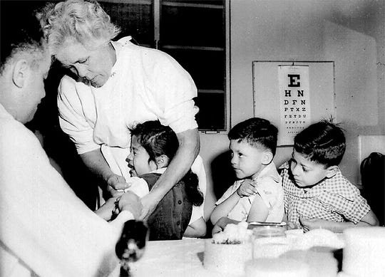 First and second graders at St. Vibiana's school are among the first to innoculated for polio with the Salk vaccine in Los Angeles, Calif., April 18, 1955.