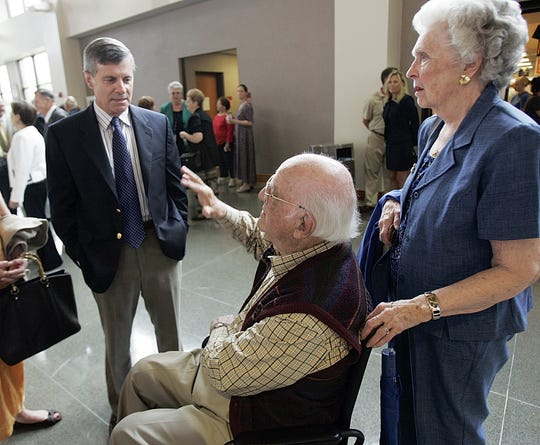 "Polio survivor Fred Campbell, (center), and his wife Peggy talk with Dr. David Oshinsky, (left), who won the 2006 Pulizter Prize award for his book ""Polio: An American Story"". Oshinsky spoke to a group that was commemorating the 75th anniversary of Shannon Medical Center at ASU's C.J.  Davidson Conference Center in May of 2007."