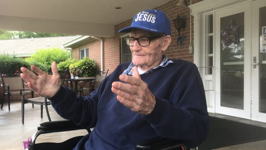 """Roy Jones, 100, of Chincoteague, Virginia demonstrates the size of the cook stove used by Chincotague watermen aboard boats when they cooked """"Down the Bay Bread."""""""