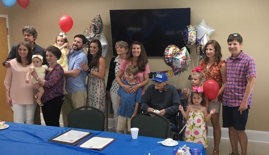 Roy Jones of Chincoteague, Virginia, seated in center, celebrates his 100th birthday with family members on Saturday, June 8, 2019 in Pocomoke, Maryland. Jones was born on June 6, 1919 in Chincoteague and spent his early years living on Assateague Island.
