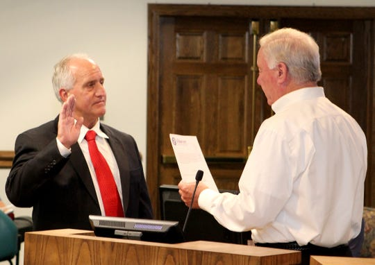 New Ocean City Fire Chief Richard Bowers is sworn in by Mayor Rick Meehan on Tuesday.