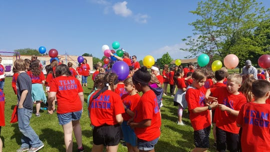 Zielanis Elementary School students get ready to release balloons in honor of Mason Lesczykowski.
