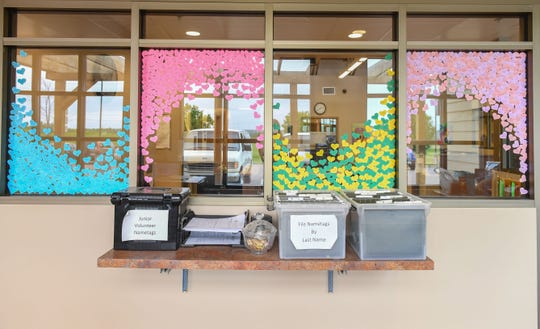 The Sioux Falls Area Humane Society will celebrate 100 years of operation this month. Paper hearts on the windows, color-coded by month, show the name and date of every animal adopted from the Humane Society so far in 2019.
