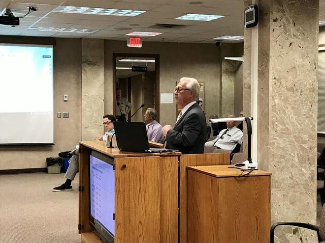 Jim Iosty, chairperson of the Minnehaha County Board of Mental Illness, presents on the board's numbers at the Minnehaha County Commission meeting Tuesday, June 11.
