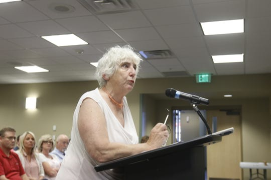 Judith Smith, who owns rental properties near Nelson Park, speaks at a Lebanon City Council meeting on Monday. Smith scolded the council members for selling the park to White River Marine Group in a closed meeting June 3.