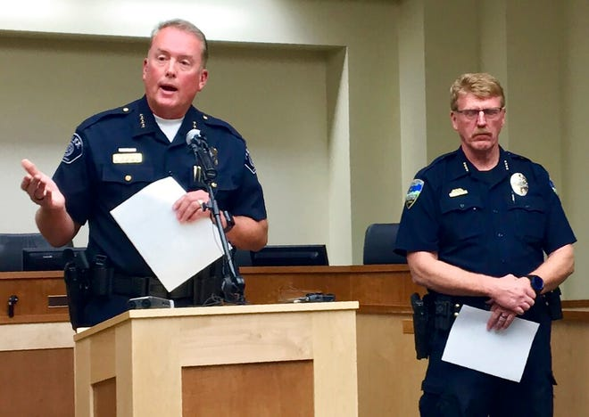 Woods Cross, Utah, Police Chief Chad Soffe, left, and Centerville Police Chief Paul Child speak at a news conference Monday, June 10, 2019, in Woods Cross. Soffe said a Woods Cross police officer who pulled his gun on a 10-year-old child will continue to work amid an independent review of the incident. Jerri Hrubes said the white officer pulled his gun on her son, DJ, who is black, while he was playing on the front lawn Thursday, June 6, 2019.  (AP Photo/Morgan Smith)