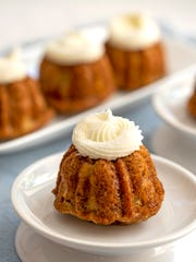 Southern Hummingbird Mini-Bundtlettes are topped with cream cheese frosting.