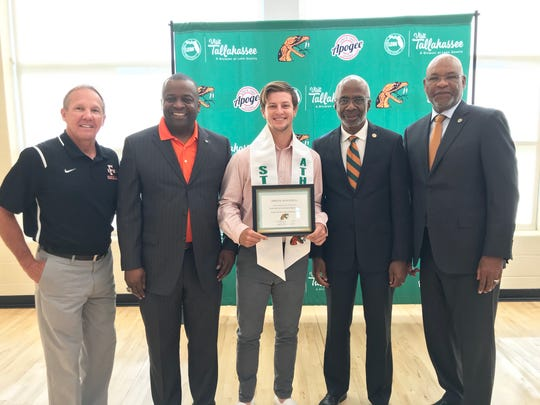From left to right: FAMU baseball head coach Jamey Shouppe, FAMU NAA president Greg Clark, catcher Bret Maxwell, president Dr. Larry Robinson and athletics director Dr. John Eason pose during the pre-commencement ceremony on May 3, 2019. Maxwell earned a 4.0 for the spring semester.