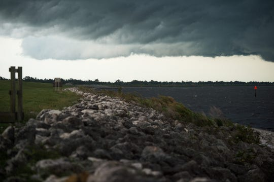 Low-hanging storm clouds fill the sky above Lake Okeechobee at Port Mayaca Lock and Dam on Monday, June 11, 2019, in Martin County.