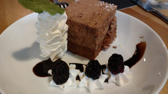 The Kit Kat, a layer of chocolate mousse on a bar of rich chocolate was adorned by whipped cream, black berries and a swirl of chocolate sauce at Vero Beach's new restaurant Michael's on 7th.