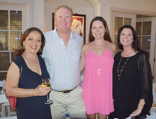 Joanne Liakas, left, Paul and Michelle Lucas and Kelly Sartain at the Jazz, Art and Fashion show benefiting New Horizons of the Treasure Coast.