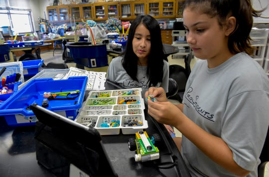 "Students Jennifer Lopez, 11 (left), and Jaya Vernese, 10, construct a Lego rover from a kit during a Lego robotics summer class, learning about STEAM (science, art, technology, engineering, mathematics) on Tuesday, June 11, 2019, during the fifth ProStudents summer camp at St. Edward's School in Indian River County. ""It's fun, I've never done this before, and I love playing with Legos and doing all this ... it's really fun for me,"" Jaya said."