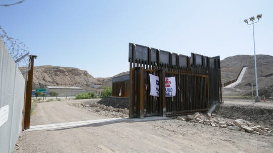 A gate built by the We Build the Wall organization has been locked in the open position, giving U.S. federal agents access to the border road near Executive Center Boulevard.