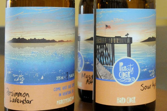 Labels for Pier City Cider show the Ventura Pier silhouetted against Channel Islands National Park in the distance. The name of each flavor is added by hand.