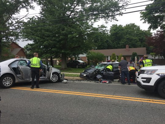 Police assist the injured after a June 6, 2017 head-on collision on Chestnut Avenue, near Highland Avenue, Vineland.