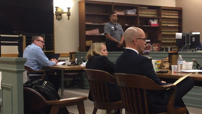 Defendant Larry John Pulcine Jr. (left, seated) watches as his defense counsel gives closing remarks on Tuesday in Cumberland County Superior Court. Pulcine is charged with a co-worker's murder in 2016. Assistant Prosecutors Lindsey Seidel and Charles J. Wettstein (center, right) represent the state in the trial.