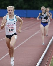 North Rockland junior Katelyn Tuohy, last year's Gatorade national girls athlete of the year,leads Saratoga's Kelsey Chmiel in the girls 3,000 during the State Track & Field Championships earlier this month. Tuohy beat the North Carolina State-bound Chmiel by nearly 15 seconds in winning the state title.
