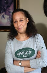 Collette V. Smith, the first woman to coach the New York Jets and NFL's first female African American female coach, at home in Queens June 11, 2019. As part of her business, Believe N You, Inc. she speaks at schools and events about empowerment, civic engagement and her personal journey.