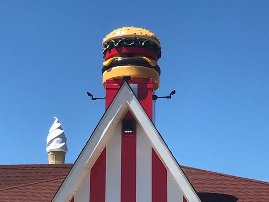 In addition to the large ice cream cone is a new large cheeseburger on top of the Red Rooster in Brewster