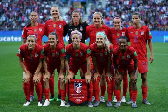 (Top L-R) United States' forward Alex Morgan, United States' midfielder Sam Mewis, United States' goalkeeper Alyssa Naeher, United States' midfielder Lindsey Horan, United States' midfielder Rose Lavelle, United States' forward Tobin Heath, (bottom L-R) United States' defender Abby Dahlkemper, United States' defender Kelley O'Hara, United States' forward Megan Rapinoe, United States' midfielder Julie Ertz and United States' defender Crystal Dunn pose prior to the  France 2019 Women's World Cup Group F football match between USA and Thailand, on June 11, 2019, at the Auguste-Delaune Stadium in Reims, eastern France.