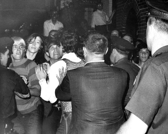 A crowd attempts to impede police arrests outside  Stonewall Inn on Christopher Street in Greenwich Village in 1969.