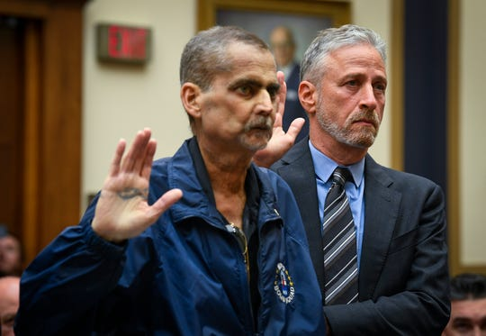Jon Stewart helps Luis Alvarez as they are sworn in before testimony in front of the House Judiciary Committee on the need to reauthorize the September 11th Victim Compensation Fund on June 11, 2019.