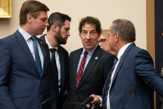 House Judiciary Committee members Rep. Eric Swalwell, D-Calif., far left, Rep. Jamie Raskin, D-Md., center, and Rep. David Cicilline, D-R.I., far right, talk before a hearing.