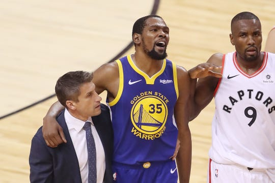Kevin Durant is helped off the court.