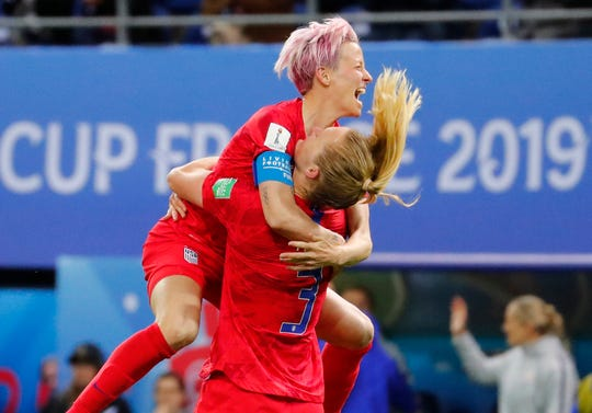 June 11: Sam Mewis (3) celebrates with Megan Rapinoe (15) during the USA's 13-0 win over Thailand in Group F.