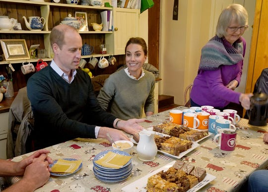Prince William Duchess Kate of Cambridge met farmers around a kitchen table during their visit to Deepdale Hall Farm, a traditional fell sheep farm, on June 11, 2019, in Patterdale in northwest England.