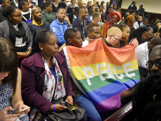Activists sit in a courtroom to wait the decision by the High Court in Gaborone, Botswana, Tuesday June 11, 2019.