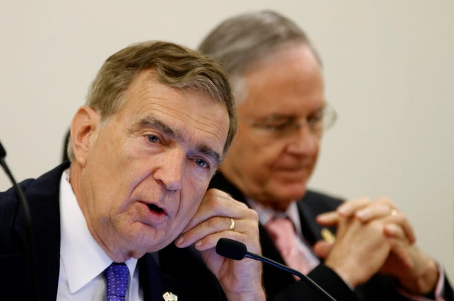 FILE - In this Tuesday, May 29, 2018 file photo, state Sen. Emmett Hanger, R-Augusta, left, speaks during a meeting of the Senate Finance Committee at the Capitol in Richmond, Va. Hanger said this week he is considering a run for the Republican gubernatorial nomination in 2021. (AP Photo/Steve Helber)