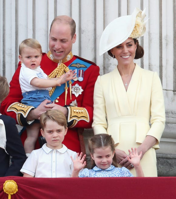 Oh, there are three royal kiddos! Clockwise, from the left: Prince Louis, Prince William, Duchess Kate, Princess Charlotte and Prince George. The royal family welcomed the crowds from the balcony of Buckingham Palace after the June 8 Trooping the Color show.
