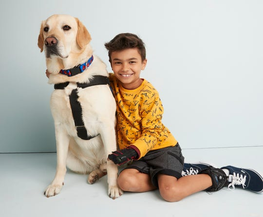 Jai Srinivasan, 8, and his dog, Banks, were models in a recent Kohl's photo shoot about new adaptive clothing.
