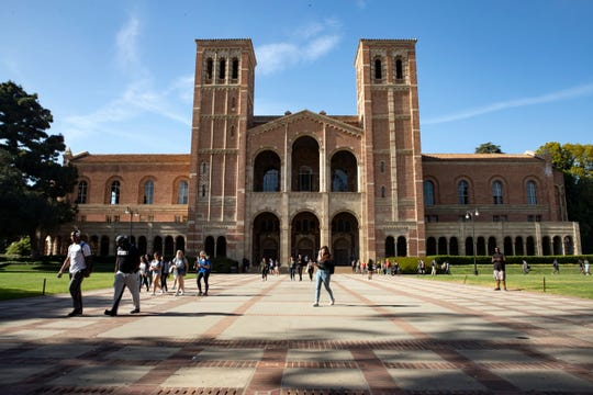 Students walk past a hall at the University of California Los Angeles (UCLA) campus in Los Angeles on April 25, 2018.