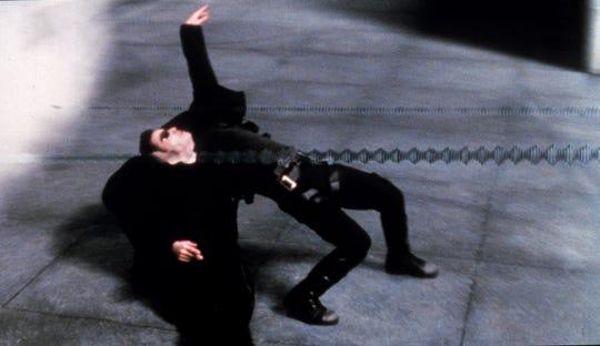Keanu Reeves plays Neo in Warner Bros' 1999 film The Matrix.
