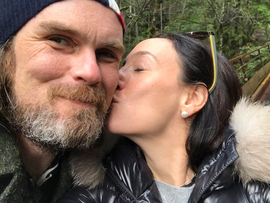 In this photo taken March 3, 2019, Jaclyn Trop is with automotive journalist Davey G. Johnson in Felton, Calif. Authorities using boats and drones are searching a river for Johnson, a veteran automotive journalist who went missing in Northern California while test-driving a motorcycle for a story. Calaveras County Lt. Anthony Eberhardt said Monday, June 10, 2019, crews are searching the Mokelumne River and a reservoir for David Gordon Johnson, who was reported missing June 5. Eberhardt said no foul play is suspected.