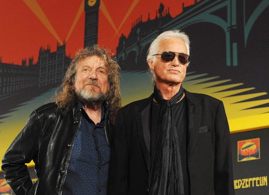 Led Zeppelin, including bandmates Robert Plant (L) and Jimmy Page (R), are accused of stealing an acoustic theme from the 1968 song 'Taurus,' written by Randy Wolfe of the US rock band Spirit, for their 1971 song 'Stairway to Heaven.'