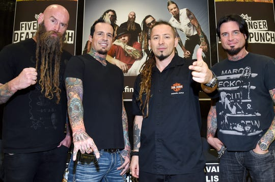 Drummer Jeremy Spencer, second from left, formerly of Five Finger Death Punch, is now a part-time cop.