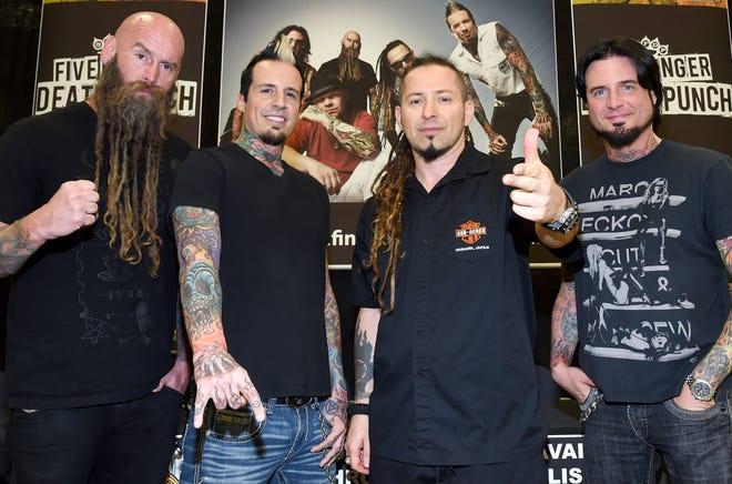 Bassist Chris Kael, drummer Jeremy Spencer, and guitarists Zoltan Bathory and Jason Hook of Five Finger Death Punch.